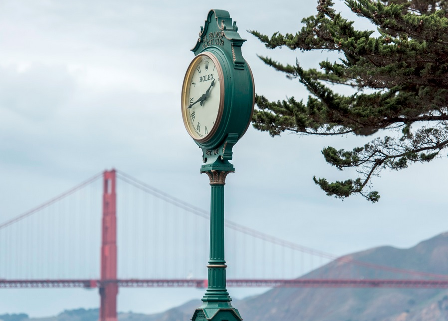 Rolex clock at the St. Francis Yacht Club with the Golden Gate Bridge in the bac
